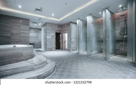 several showers seperated with walls of glass and mirror.