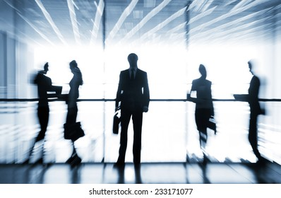 Several  silhouettes of businesspeople interacting  background business centrer
