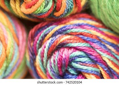 Several skeins of multicolored yarn stacked up.