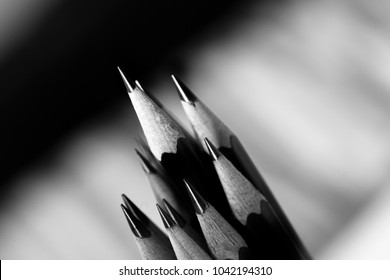 Several Sketch Pencils sharpened with fine points. Image black and white