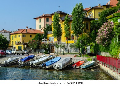 Several small boats lying on the shore of lake Como in Varenna, Italy