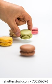 several small macarons of different flavors on a white background