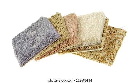 Several small squares of carpet samples on a white background.
