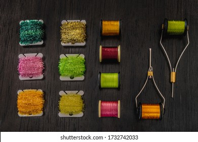 several spools of thread of various types and colours for tying flies. hobby concept