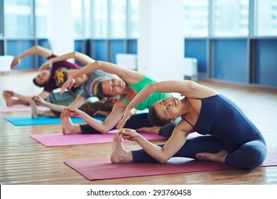 Several sporty people making stretching exercise