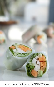 several spring rolls with focus on one closest to the camera