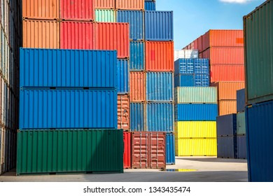 Several stacks of colorful containers in the industrial port