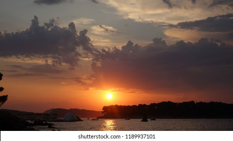 Several stages of a sun set by the ocean in dubrovnik