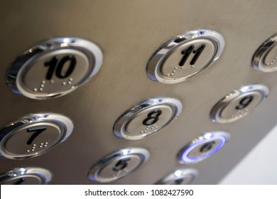 several stainless steel elevator panel push buttons, metal buttons in the Elevator, selective focus