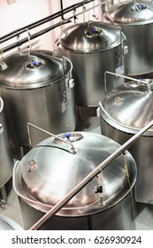 Several steel cylindrical tanks. Glossy and clean surface of stainless steel.