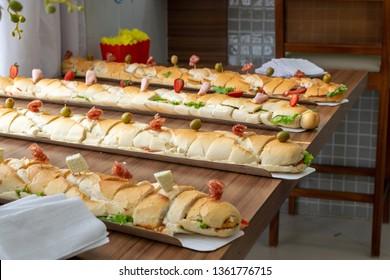 several sub sandwiches (submarine, sub, wedge, hoagie, hero or g