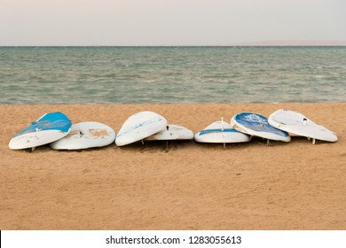 several surfboards by the sea. Surf boards on idyllic tropical sand.