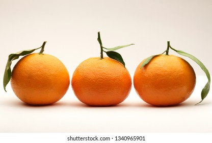 Several tangerines isolated on white background