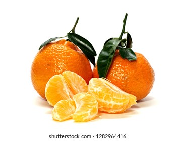 Several tangerines with stems and leaves one open with split single fruit.