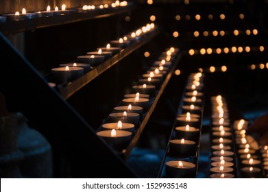 Several tea candles burning in cathedrale