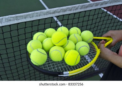 Several tennis balls on racket