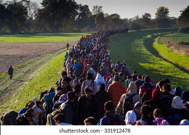 Several thousand refugees are wandering into the direction of Deutscland Dramatical picture from European refugees crisis see my collection from refugees 25.10.2015 Slovenia Breznice;