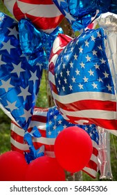 Several toy helium balloons with the North American flag