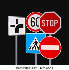 Several Traffic Signs at Black Background