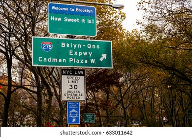 Several traffic signs at one of the entrances to Brooklyn, New York.
