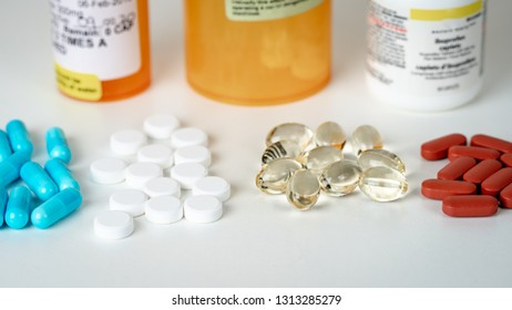 Several Types of Pills with Pill Bottles
