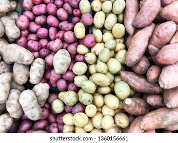 Several types of Potatoes make a Potato background