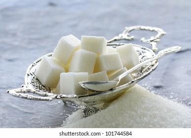 Several types of sugar - refined sugar and granulated sugar