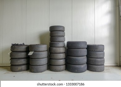 several tyre stacks in a garage