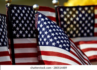 Several United States Flags close up shallow depth of field
