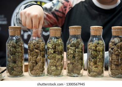 Several varieties of Cannabis Sativa, in glass tubes, for sale at a market stall.