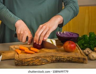 Several vegetables on top of a wooden board. Ingredients for detox juice.