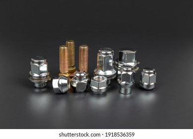 several wheel nuts and studs for repairing the fastening of the wheel to the car