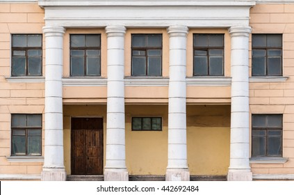 Several windows in a row on facade and portico of urban office building front view, St. Petersburg, Russia