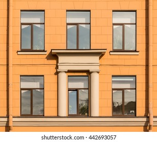 Several windows in a row on facade of Secondary school , St. Petersburg, Russia