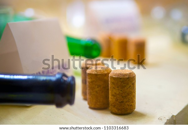Several wine corks and fragment of wine bottle on wooden surface close