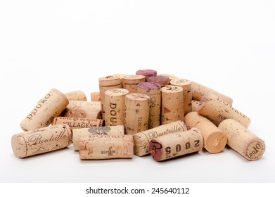 """Several Wine Corks on a white background. You can read """" Mis en Bouteille"""" (filled in the bottle or bottled) or the Origin of the Wine and or the Vintage on them."""