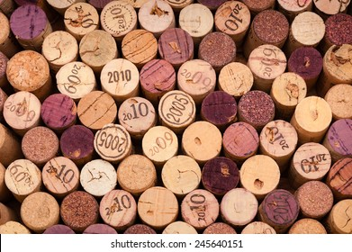 Several Wine Corks seen from above. The Vintage is printed on some of them.