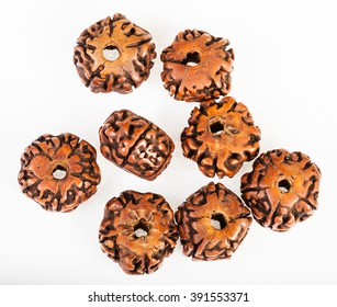 several wooden beads from Rudraksha tree seeds on white background