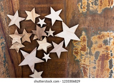 Several wooden stars lie on an old wooden table