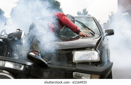 Severe accident between a motorcyclist and a car, injuring both drivers and causing a lot of damage