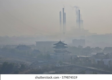 Severe fog and haze, power plants are the big chimney emissions along the Yangtze River in the eastern Chinese city of Jiujiang.