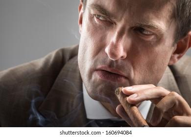 Severe gaze of elegant adult smoker