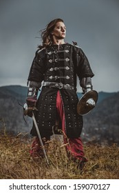 Severe medieval warrior on the shore