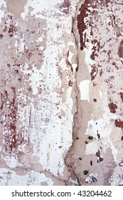 Severe paintless and cracked pink wall texture.
