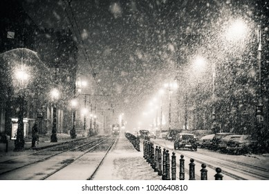 Severe powerful snow in Warsaw. One snowy winter night in the city.