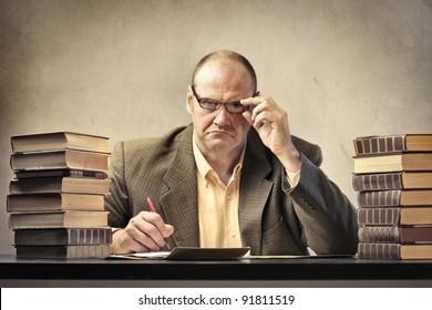 Severe teacher using a calculator