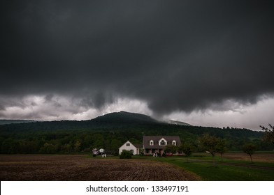 A severe thunderstorm over a house in the Pennsylvania mountains.