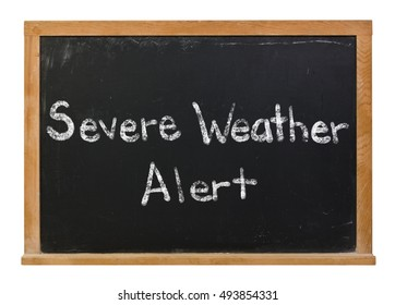 Severe weather alert written in white chalk on a black chalkboard isolated on white