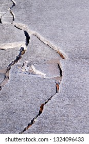 Severely damaged broken cement sidewalk with copy space.
