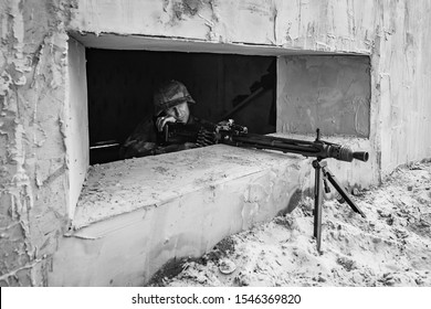 SEVERODVINSK. Festival SEVERODVINSK LANDING, 27 JUL 2014 The reconstruction of the battle of 1941-1945, second world war. German machine gunner firing a machine gun while in the bunker.